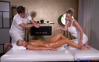 Oiled guy gets lucky and fucks two models insusceptible to the massage table