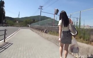 Amateur Japanese chick gets her hands in excess of a friend's stiff dick